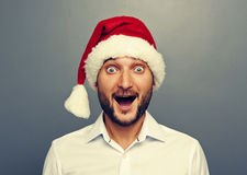 Homem engraçado do Natal sobre o cinza Fotografia de Stock