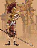Homem engraçado dos desenhos animados em uma roupa dos gladiadores nas ruínas Imagem de Stock