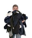 Homem engraçado Armload, roupa, lavanderia suja isolada Imagem de Stock Royalty Free