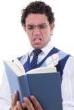 Homem enojado pelo livro Imagem de Stock Royalty Free