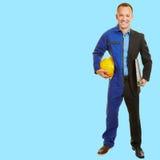 Homem entre a mudança de trabalho na roupa de trabalho Imagens de Stock Royalty Free