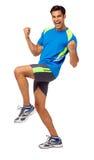Homem entusiasmado na roupa dos esportes que comemora o sucesso Fotografia de Stock Royalty Free
