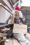 Homem envelhecido infeliz que pede a ajuda foto de stock royalty free