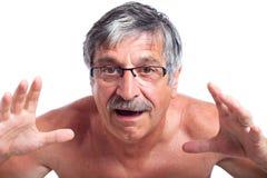 Homem envelhecido médio surpreendido imagem de stock royalty free