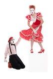 Homem espantado que olha sob o vestido dos womans Imagens de Stock Royalty Free