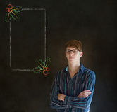 Homem, estudante ou professor olhando o com menu do azevinho do Natal dos vidros para fazer a lista de verificação Imagens de Stock