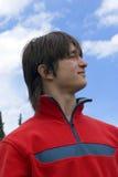 Homem europeu dos adolescentes no vermelho foto de stock royalty free