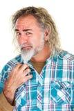 Homem farpado com cara confusa Foto de Stock Royalty Free