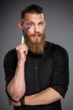 Homem farpado com fita da medida Imagens de Stock Royalty Free