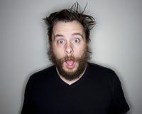 Homem farpado que olha a câmera chocada Imagem de Stock