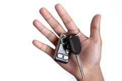 Homem feliz com chave nova do carro Fotografia de Stock