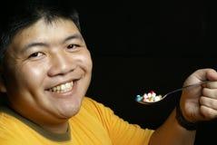 Homem feliz com comprimidos Fotografia de Stock Royalty Free
