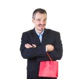 Homem feliz com o saco vermelho de compra. imagens de stock