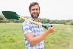 Homem feliz com sua pá Fotos de Stock Royalty Free