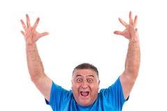 Homem feliz com suas mãos acima Fotos de Stock Royalty Free