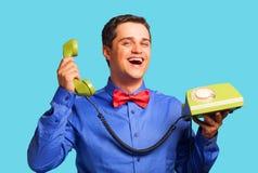Homem feliz com telefone Foto de Stock Royalty Free