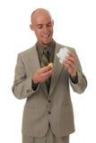Homem feliz com um ovo dourado fotografia de stock royalty free