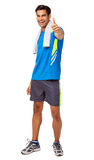Homem feliz do ajuste que gesticula os polegares acima Fotografia de Stock Royalty Free