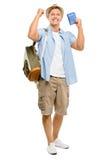 Homem feliz do turista que mantem o passaporte isolado no fundo branco imagens de stock