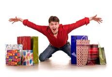 Homem feliz engraçado alegre da compra. Fotografia de Stock Royalty Free