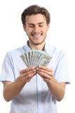 Homem feliz ocasional que guarda o dinheiro Foto de Stock Royalty Free