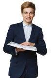 Homem feliz que lê o livro Fotos de Stock