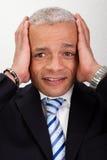 Homem forçado do homem de negócios com dor de cabeça imagens de stock royalty free