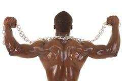 Homem forte com cabo flexível da parte traseira da corrente Imagens de Stock