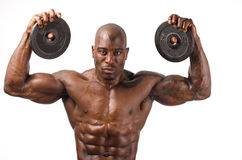 Homem forte do halterofilista com Abs, os ombros, o bíceps, o tríceps e a caixa perfeitos Imagens de Stock