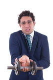 Homem fraco no terno que levanta um peso Imagem de Stock Royalty Free