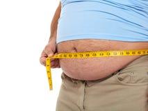 Homem gordo com uma barriga grande. fotografia de stock