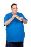 Homem gordo feliz com um grande pão Imagens de Stock