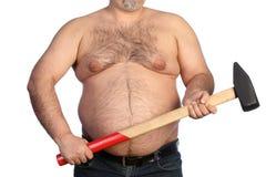 Homem gordo forte que guarda um martelo grande imagem de stock royalty free