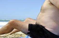 Homem gordo na praia Imagens de Stock Royalty Free