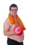Homem gordo que faz o exercício com dumbbells Foto de Stock