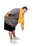 Homem gordo que joga o esporte Imagem de Stock Royalty Free