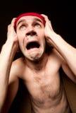 Homem gritando terrificado que prende sua cabeça Imagens de Stock Royalty Free
