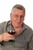 Homem idoso com vinho vermelho Fotografia de Stock