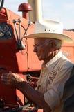 Homem idoso e seu trator Fotografia de Stock Royalty Free