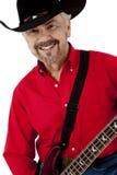 Homem idoso feliz atrativo com guitarra e Cowbo fotos de stock royalty free