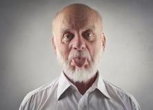 Homem idoso que faz gracejos Imagem de Stock Royalty Free