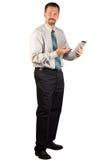 Homem incorporado que está e que usa uma tabuleta Fotos de Stock