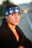 Homem indígeno pelo lado da estrada imagem de stock royalty free