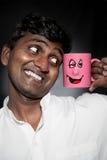 Homem indiano com caneca engraçada Imagem de Stock Royalty Free