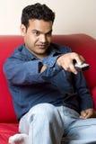 Homem indiano com de controle remoto imagem de stock