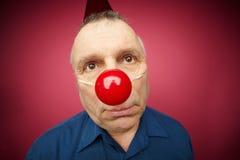 Homem infeliz com nariz vermelho Imagens de Stock