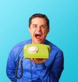 Homem irritado com telefone Fotos de Stock