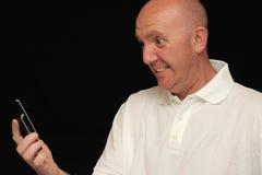 Homem irritado com telemóvel Imagem de Stock Royalty Free
