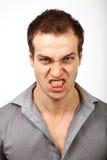 Homem irritado da virada com cara assustador foto de stock