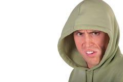 Homem irritado na capa Fotos de Stock